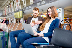Business couple at the airport Stock Photography