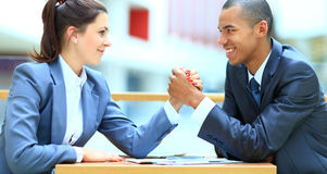 Business couple arm wrestling Royalty Free Stock Images