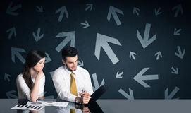 Business couple with arrows in background Stock Image