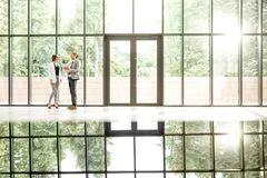 Business couple at the beautiful office hall Royalty Free Stock Photography