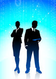 Business Couple on Binary Code Background Royalty Free Stock Photography