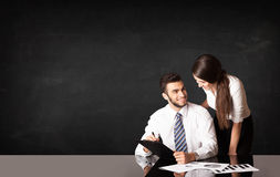 Business couple with black background Stock Images