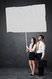 Business couple with blank booklet paper Stock Photography