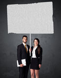 Business couple with blank booklet paper Royalty Free Stock Image