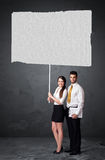 Business couple with blank booklet paper Royalty Free Stock Images