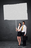 Business couple with blank booklet paper Stock Photos