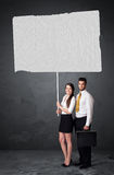 Business couple with blank booklet paper Royalty Free Stock Photo