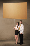 Business couple with blank cardboard Stock Photo