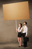 Business couple with blank cardboard Stock Photography