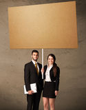 Business couple with blank cardboard Royalty Free Stock Image