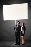 Business couple with blank whiteboard Royalty Free Stock Photography