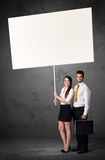 Business couple with blank whiteboard Stock Photography