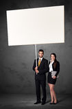 Business couple with blank whiteboard Royalty Free Stock Photo