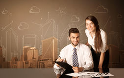 Business couple with buildings and measurements Royalty Free Stock Images