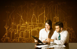 Business couple with buildings and numbers Royalty Free Stock Photography