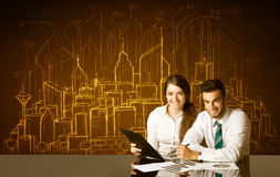 Business couple with buildings and numbers Stock Photography