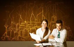 Business couple with buildings and numbers Stock Images