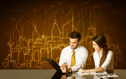 Business couple with buildings and numbers Royalty Free Stock Photos