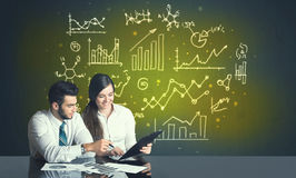 Business couple with business diagrams Royalty Free Stock Image