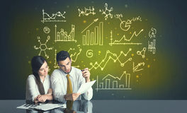 Business couple with business diagrams Stock Photo