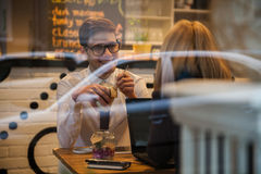 Business Couple In Cafe Stock Photo