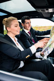 Business couple in car travelling Royalty Free Stock Image