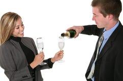 Business couple celebrating Royalty Free Stock Photos
