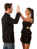 Business couple celebrating success, clapping with hands. Team w Royalty Free Stock Photos