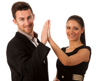 Business couple celebrating success, clapping with hands. Team w Stock Images