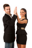 Business couple celebrating success, clapping with hands. Team w Royalty Free Stock Photo