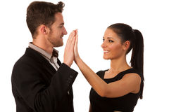 Business couple celebrating success, clapping with hands. Team w Stock Photo