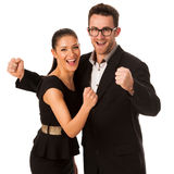 Business couple celebrating success holding fists and screaming Stock Image