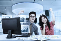 Business couple celebrating their success Stock Images