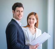 Business couple checking report in office business royalty free stock photography