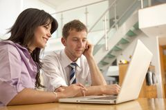 Business couple on the computer Royalty Free Stock Images