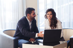 Business couple with computer Stock Photos