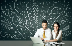 Business couple with curly lines and arrows Royalty Free Stock Photos