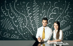 Business couple with curly lines and arrows Royalty Free Stock Image