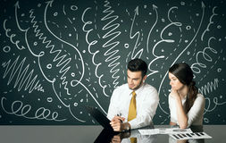 Business couple with curly lines and arrows Stock Images