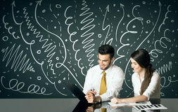 Business couple with curly lines and arrows Stock Photo