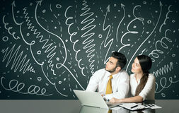 Business couple with curly lines and arrows Stock Photography