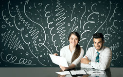 Business couple with curly lines and arrows Stock Image