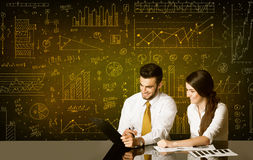 Business couple with diagram background Royalty Free Stock Photography
