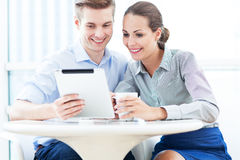 Business couple with digital tablet Stock Image
