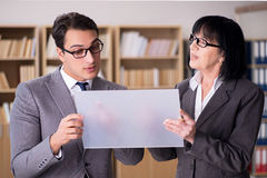 The business couple discussing business results on tablet Stock Photos