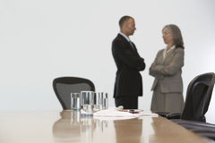 Business Couple In Discussion At Office Stock Images