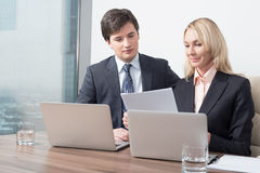 Business couple is double checking some essential business information. Stock Image