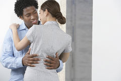 Business Couple Embracing Stock Photo