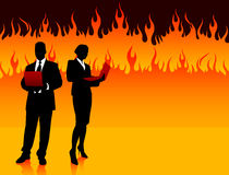 Business Couple on Fire Background Stock Photos