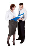 Business couple with a folder Royalty Free Stock Photography